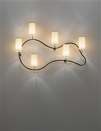 important and rare freeform wall light by jean royère