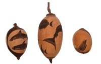 a trio of carved boab nuts by basil albert