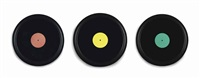 three framed grooveless records with colored labels (in 3 parts) by christian marclay