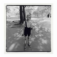 child with a toy hand grenade in central park, n.y.c., 1962 by diane arbus