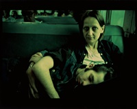 suzanne and philippe on the train, long island by nan goldin