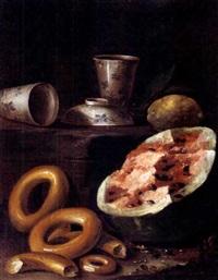 natura morta con ciambelle e anguria e, sopra un basamento tazzine di porcellana cinese e un limone by cristoforo munari