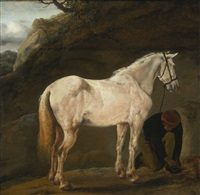 white horse in a landscape with a groom by philips wouwerman