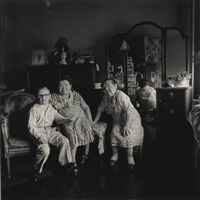 russian midget friends in a living room on 100th st, n.y.c., 1963 by diane arbus