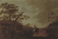 a wooded landscape at sunset with a horseman and his dog on a track by aelbrecht verschuur
