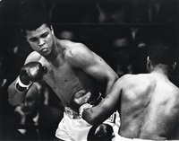 muhammad ali fighting floyd patterson at the flamingo hotel, las vegas by eddie adams