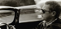 steve mcqueen driving his xk-55 jaguar through nichols canyon in the hollywood hills by sid avery