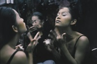 yogo and c putting on make-up, second tip, bangkok by nan goldin