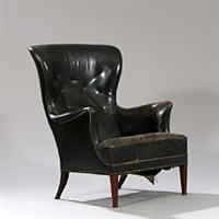 wingback chair with profiled tapering legs of mahogany by frits henningsen