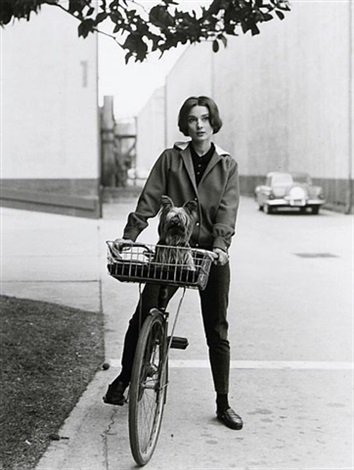 audrey hepburn on her bike with pet dog famous at paramount by sid avery