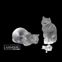 larger and minor glass figures in the shape of cats and an exhibition sticker cut with inscription lalique by rené lalique