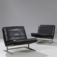 a pair of easy chairs with frame of matte chromed steel by preben fabricius and jørgen kastholm
