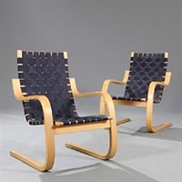 a pair of easy chairs with steam bent birch by alvar aalto