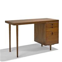 single pedestal desk by eero saarinen and charles eames