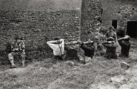 near st lô july 26th 30th 1944 american soldiers with a group of recently captured german soldiers by robert capa