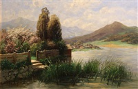 a garden at river's edge with mountains in the distance by theodor her