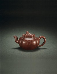 teapot decorated with crouching lion by wu yungen