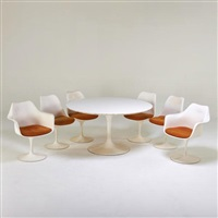 tulip dining table and six chairs by eero saarinen