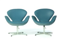 pair of swan chairs by arne jacobsen