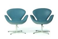 pair of swan chairs by arne jacobsen