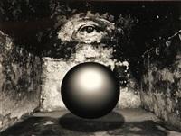 untitled (floating sphere in eye room) by jerry uelsmann