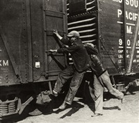 young men hopping a train for a ride by walker evans