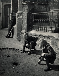 girls playing marbles on the street by tibor honty