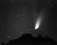 comet in starry sky by manfred grohe