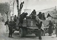 the camion arrives by robert capa