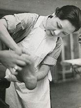 madame chiang kai-shel caring for the wounded by robert capa