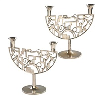 candlesticks with cats and dogs (pair) by franz hagenauer