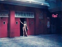 nude in theatre doorway by helmut newton