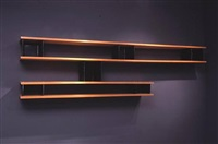 asymmetrical wall-mounted bookshelves by jean prouvé and charlotte perriand
