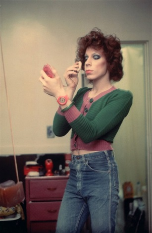 kenny putting on make-up, boston 1973 by nan goldin