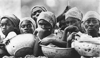 haitian women waiting for food supplies by eddie adams