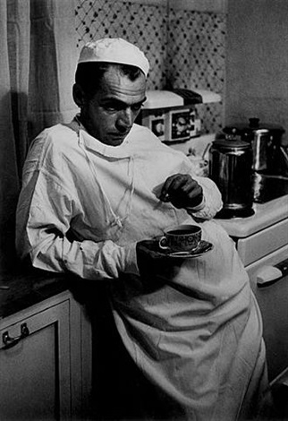 doctor with coffee cup by w. eugene smith
