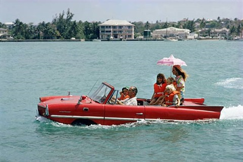 "sea drive, 1967, kevin mcclory and his wife bobo segrist in the ""amphicar"" at nassau by slim aarons"