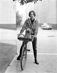 audrey hepburn on her bike with pet dog,