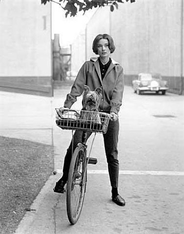 "audrey hepburn on her bike with pet dog, ""famous"", paramount studios by sid avery"