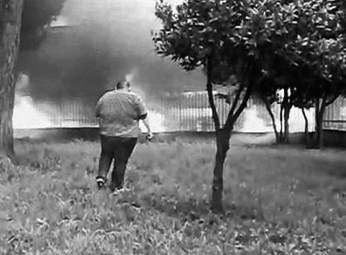 burned builings (found scene), via argine, ponticelli, naples, italy. june 2008 by santiago sierra