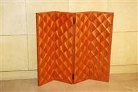 paravent bas à quatre feuilles, le dos en sycomore, l'avant en marqueterie de paille rousse à décor d'éventails. by jean-michel frank