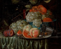 still life of fruit arranged on a draped table with pewter plate and chinese porcelain bowl by jan pauwel gillemans the elder