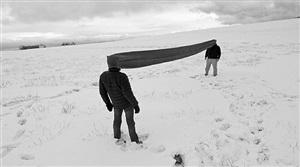"franz erhard walther and santiago sierra demonstratingno. 46 from walther's first workset (""sehkanal"", 1968), rhön high plain, germany by santiago sierra"