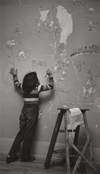 juanita writing on a wall by w. eugene smith