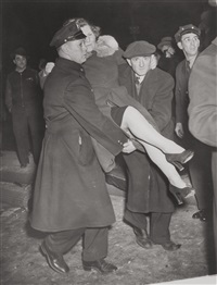 untitled (woman carried by policemen) by weegee