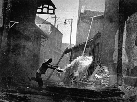 after a japanese air raid, china, 1938 by robert capa