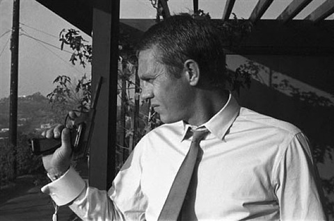 steve mcqueen with pistol at his hollywood hills home by sid avery
