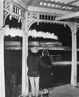 mr. and mrs. ben pope watch the last steam powered passenger train. max meadows, virginia by o. winston link