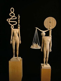 left sculpture: <i>oconomowoc</i> right: <i>city scape</i> by john buck