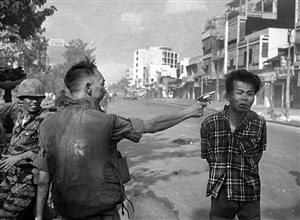 gen. nguyen ngoc loan, south vietnamese chief of the national police, fires his pistol into the head of suspected viet cong official nguyen van lem on a saigon street early in the tet offensive by eddie adams